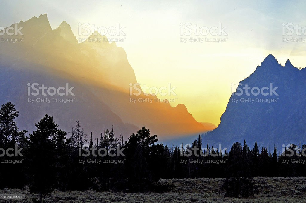 Sunset rays in The Grand Tetons. stock photo