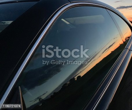 Sunset reflecting in the car window