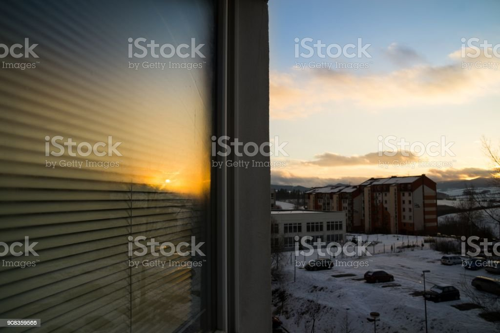 Sunset reflection in a window. stock photo