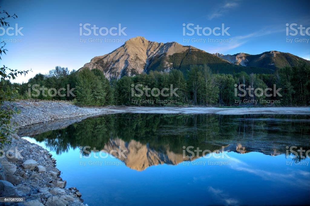 Sunset reflections at Island Lake near Crowsnest Pass, Alberta, Canada. stock photo