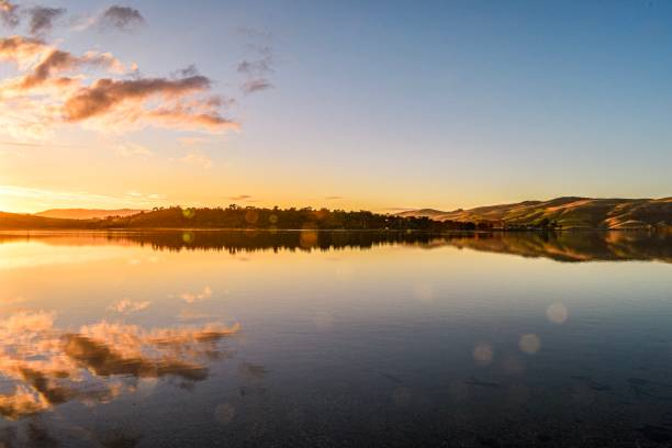 Sunset reflections on the Catlins River, Otago New Zealand stock photo