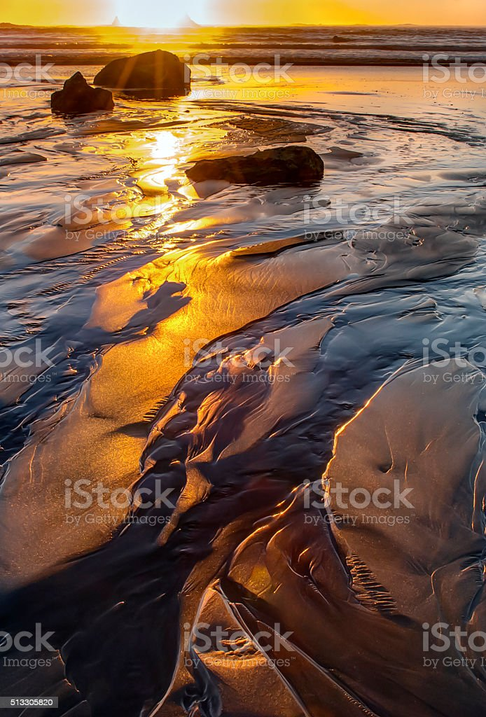 Sunset Reflects and Illuminates Tidal Waters at Second Beach stock photo