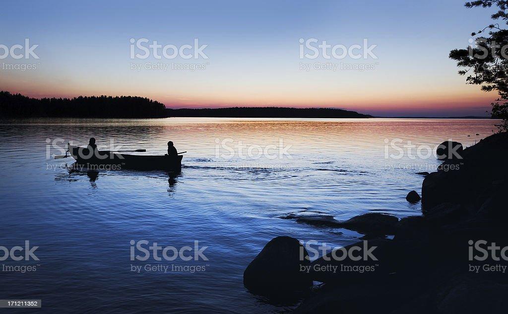 sunset rowboat royalty-free stock photo