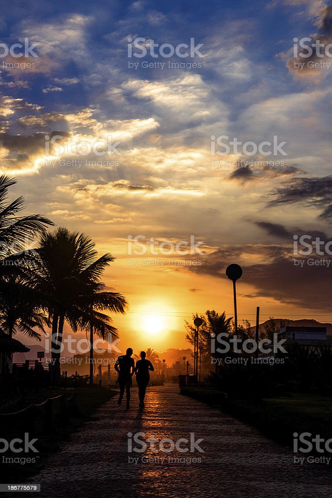 Sunset runners royalty-free stock photo