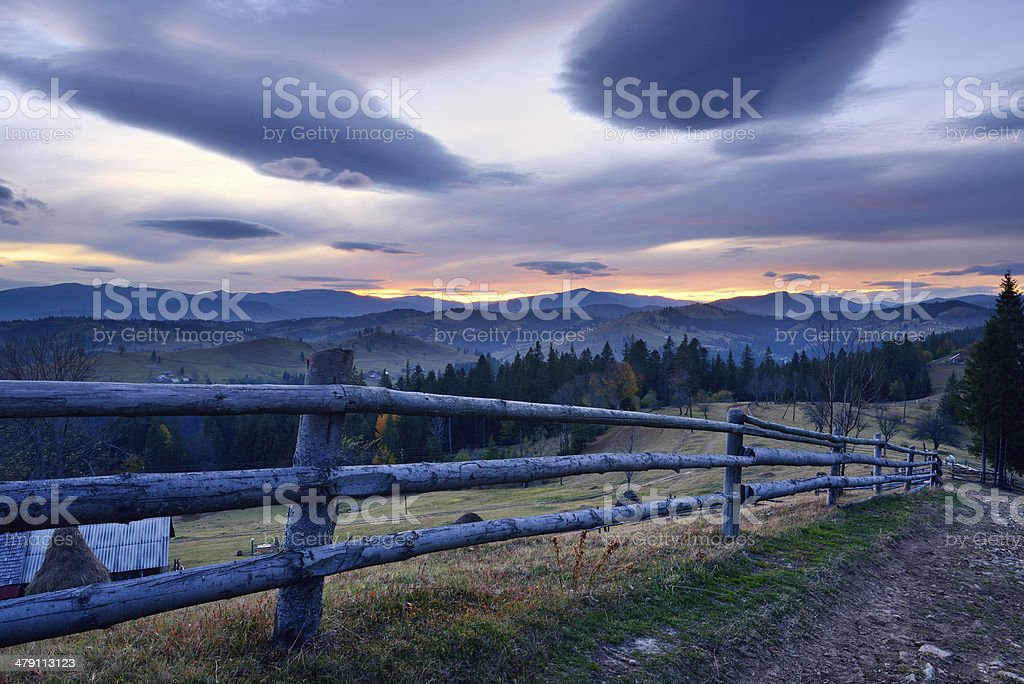 Sunset rural landscape in mountain village with dramatic sky royalty-free stock photo