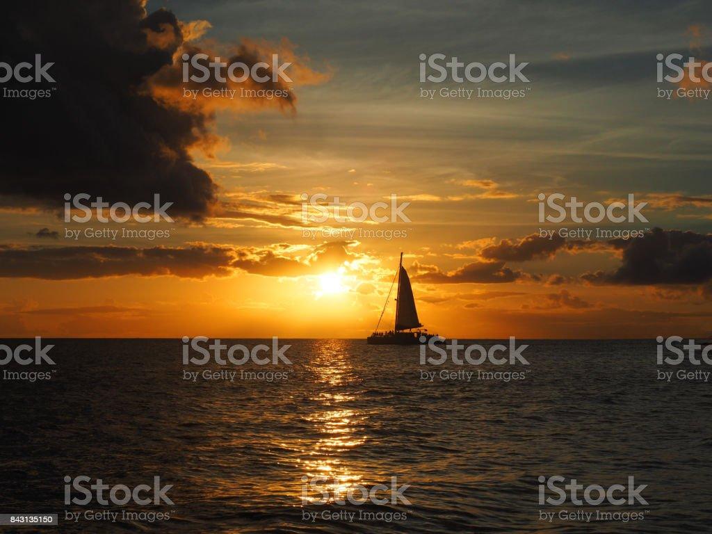 Sunset Sailing One stock photo
