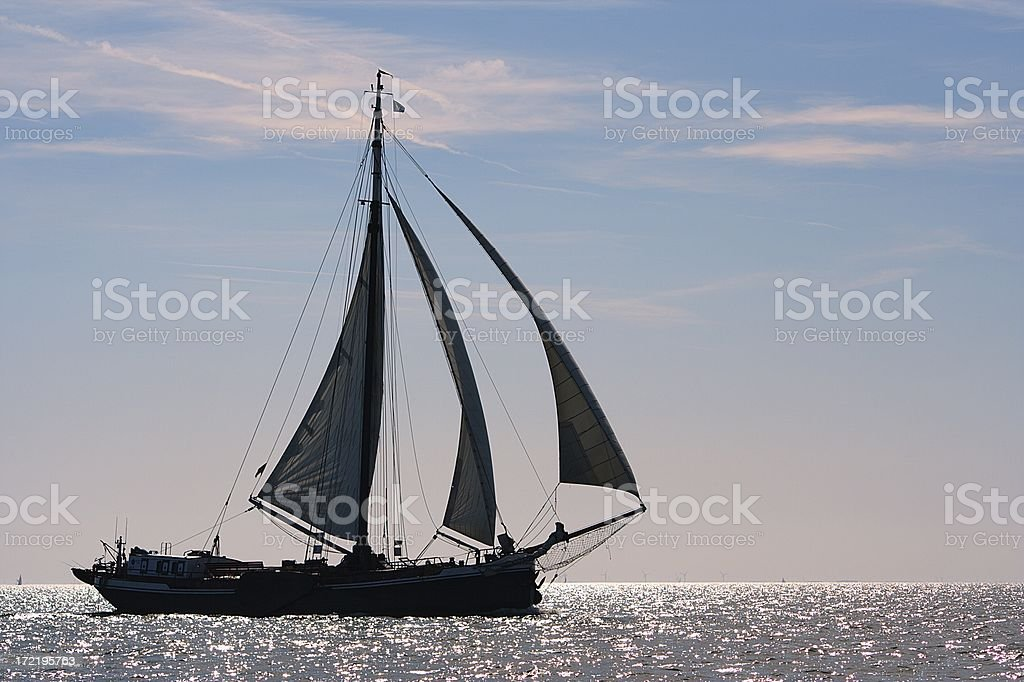 Sunset sailing with a traditional classic charter ship royalty-free stock photo