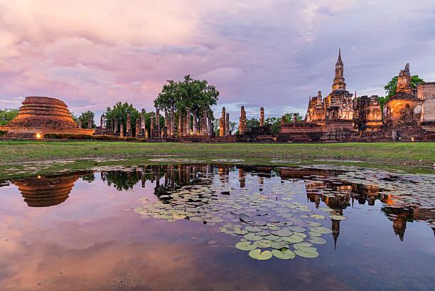 Sunset scene at sukhothai historical park Thailand stock photo