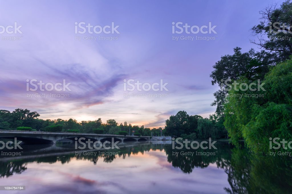 Sunset scene in a park near a lake stock photo