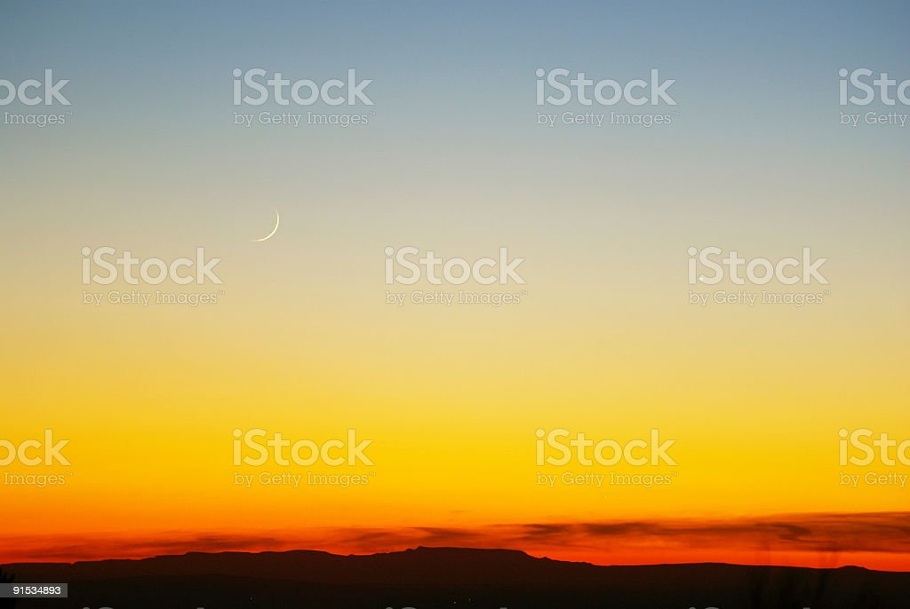 sunset sickle moon, sky, and abstract landscape stock photo