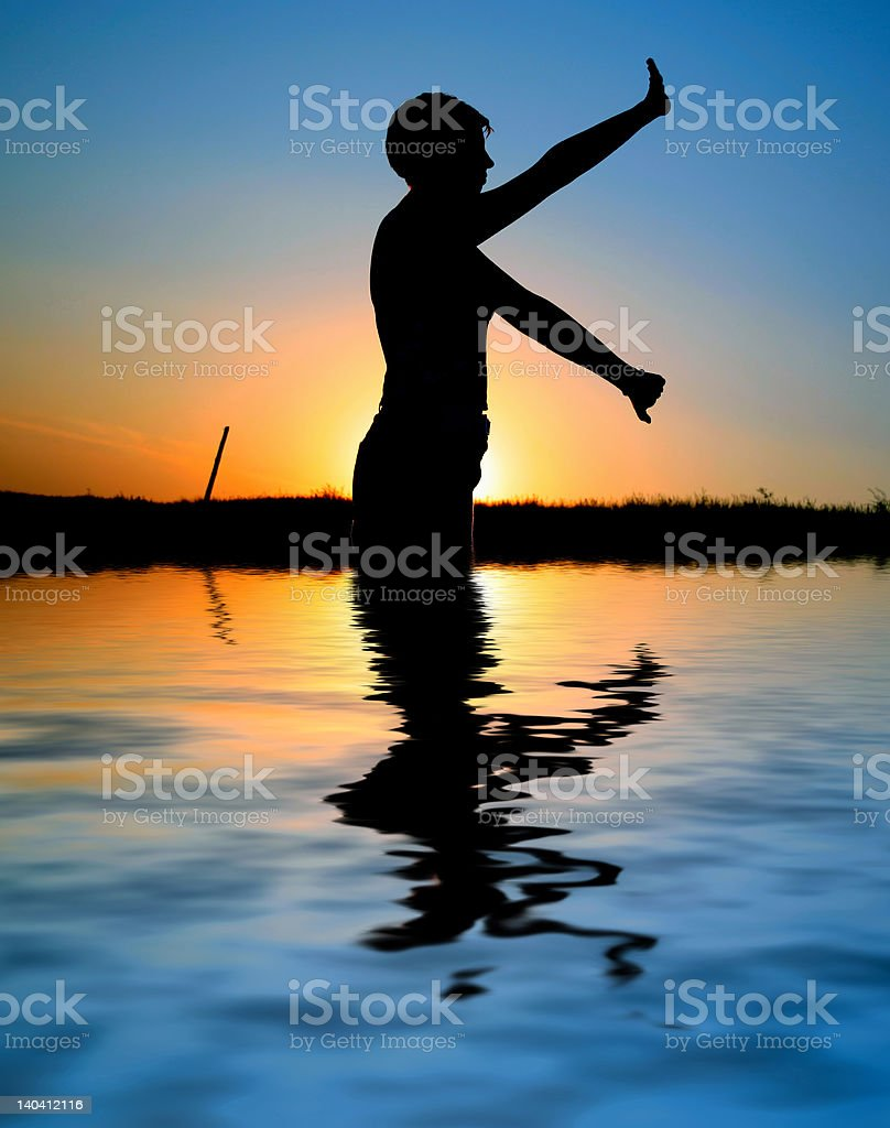 sunset silhouette doing excercises royalty-free stock photo