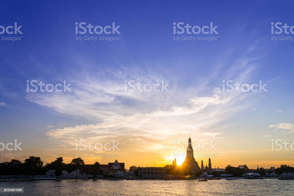 Sunset silhouette of Wat Arun (Temple of Dawn) is landmark of Attractions's Popular tourists, in bangkok Thailand stock photo