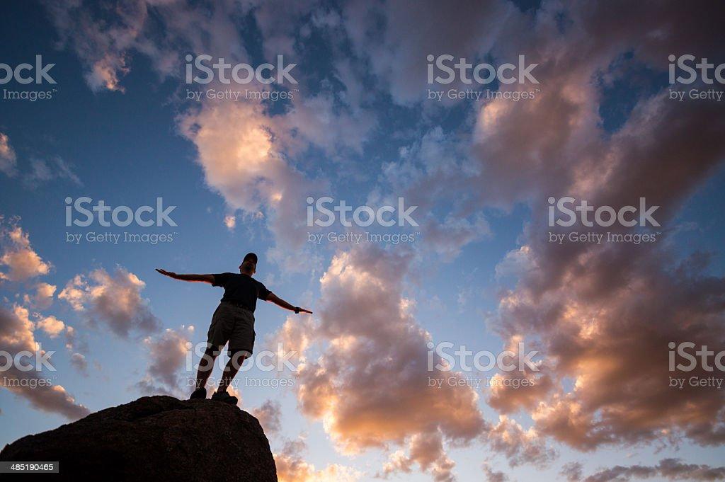 sunset silhouette spiritual man stock photo