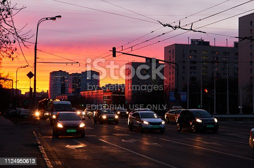820883024 istock photo Sunset silhouettes of cars and buses in Moscow under dusk dramatic sky in winter 1124950613