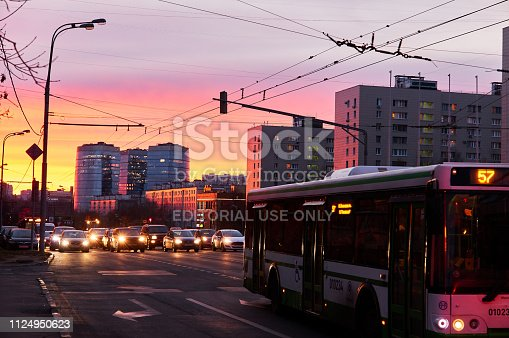 820883024 istock photo Sunset silhouettes of cars and buses in Moscow under dusk dramatic sky in winter 1124950623