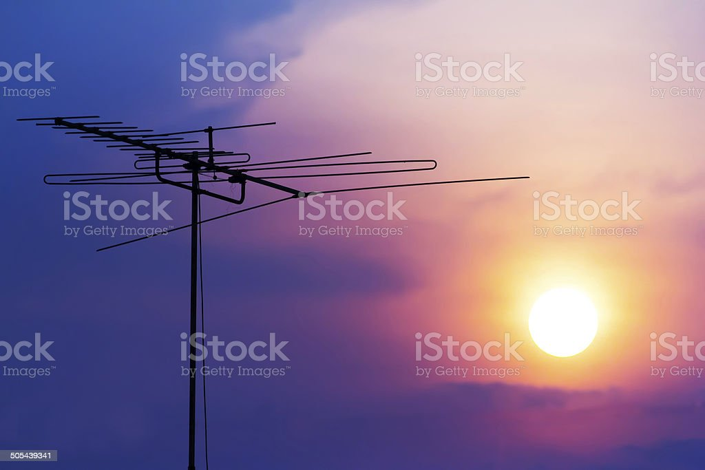 Sunset sky and cloud Silhouette TV antenna stock photo
