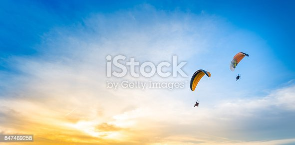 istock sunset sky background with paramotor 847469258