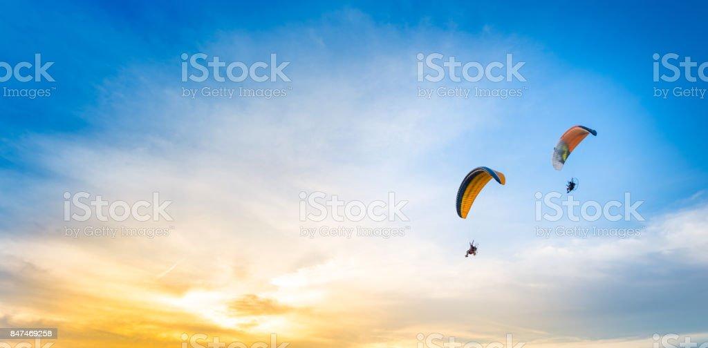sunset sky background with paramotor stock photo
