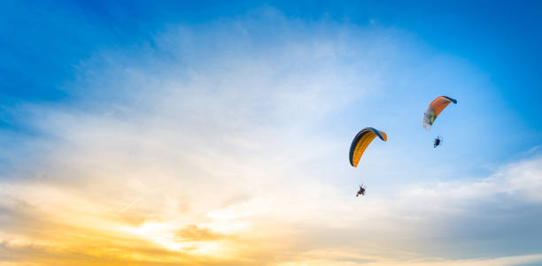 sunset sky background with paramotor sunset sky background with paramotor adventure sport paragliding stock pictures, royalty-free photos & images