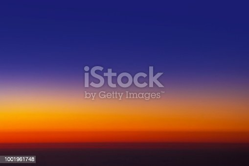 istock Sunset sky from the airplane window at height 35,000 feet. 1001961748