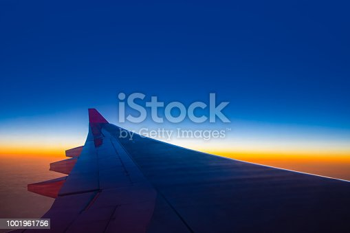 925925874 istock photo Sunset sky from the airplane window at height 35,000 feet. 1001961756