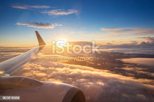 istock Sunset sky on airplane window over Copenhagen, Denmark in Friday 902818356