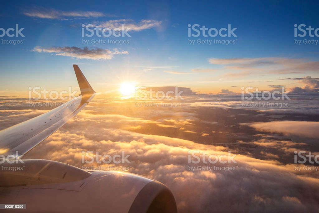 Sunset sky on airplane window over Copenhagen, Denmark in Friday stock photo