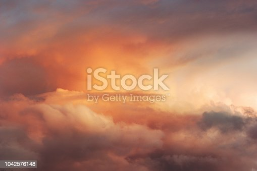 istock Sunset Sky over clouds Landscape Travel serene tranquil view flying beautiful natural colors 1042576148