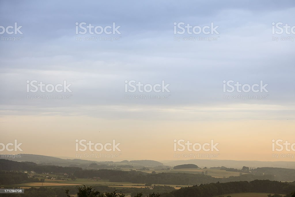 sunset sky over valley stock photo