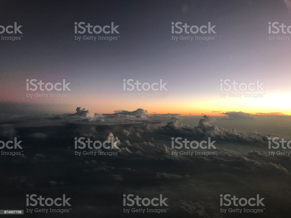 Sunset Sky Clouds taken at sunset from a Hawker 400 aircraft Aerial View Stock Photo