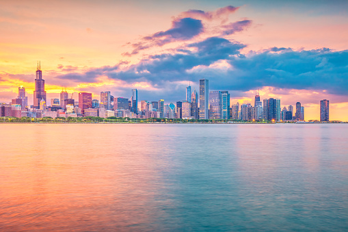 Skyline of the lakefront and Lake Michigan in downtown Chicago Illinois USA at sunset.