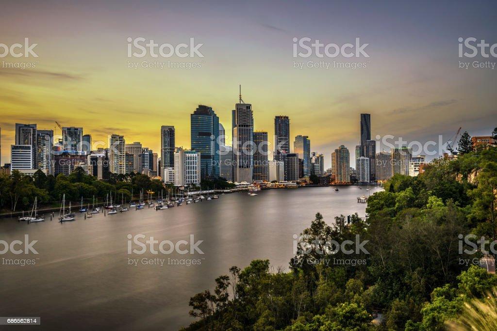 Sunset skyline of Brisbane city and Brisbane river  from Kangaroo Point Cliffs, Australia stock photo