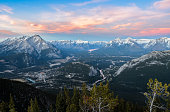 Stunning twilight panoramic view of Bow Valley and town of Banff surrounded by Canadian Rocky mountains in at Banff National Park in Alberta, Canada. View from Banff Gondola Sulphur Moutain