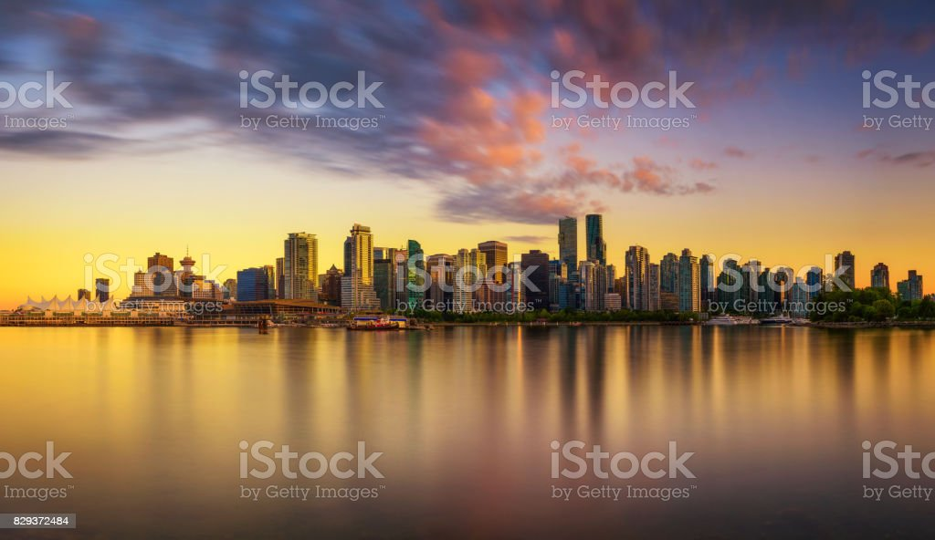 Sunset skyline of Vancouver downtown from Stanley Park stock photo