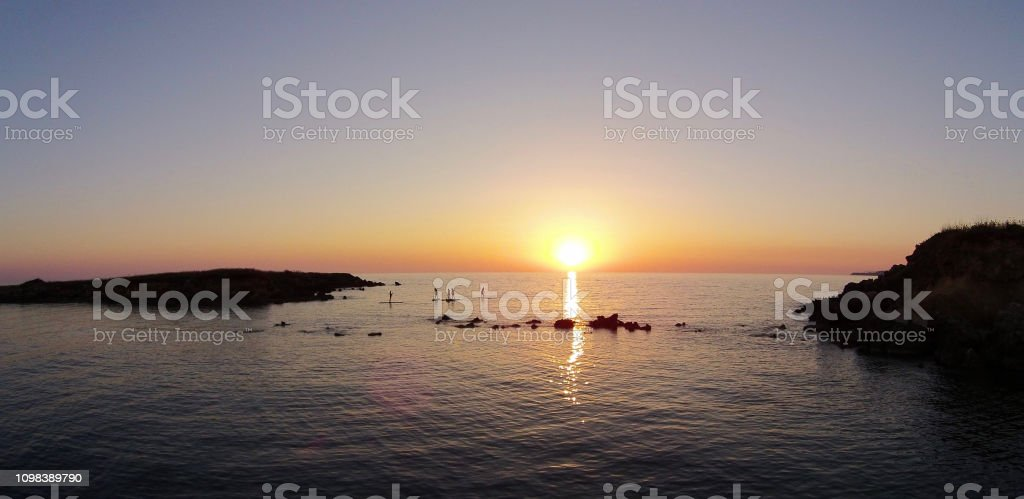 Sunset Stand-up Paddle Boaders stock photo