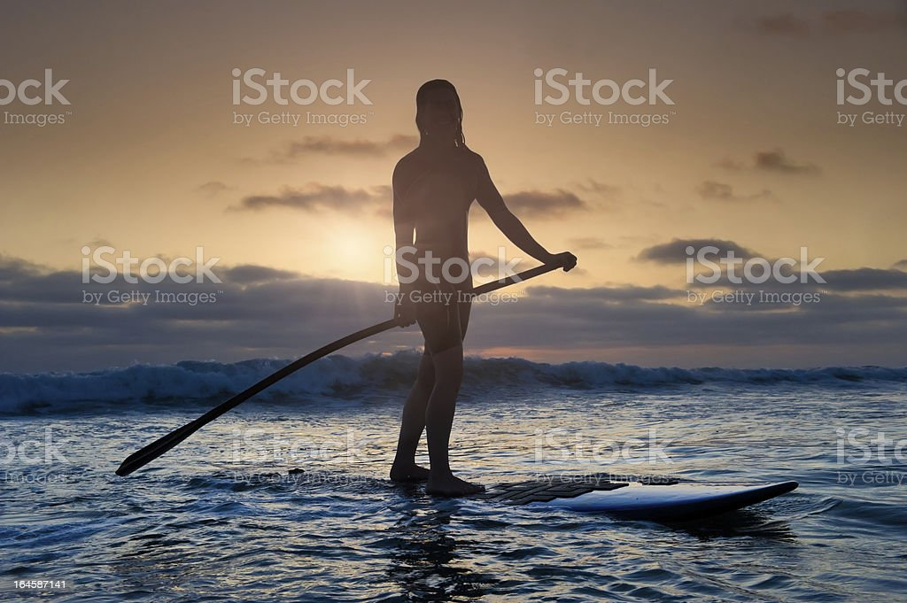 Sunset Stand-Up Paddle Boarding stock photo