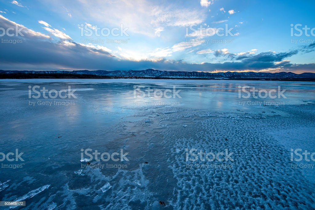 Sunset Stormy Icy Lake stock photo