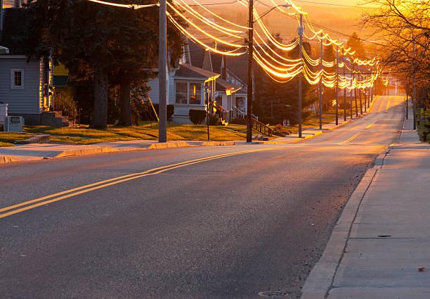 sunset street - suburban street stock photos and pictures