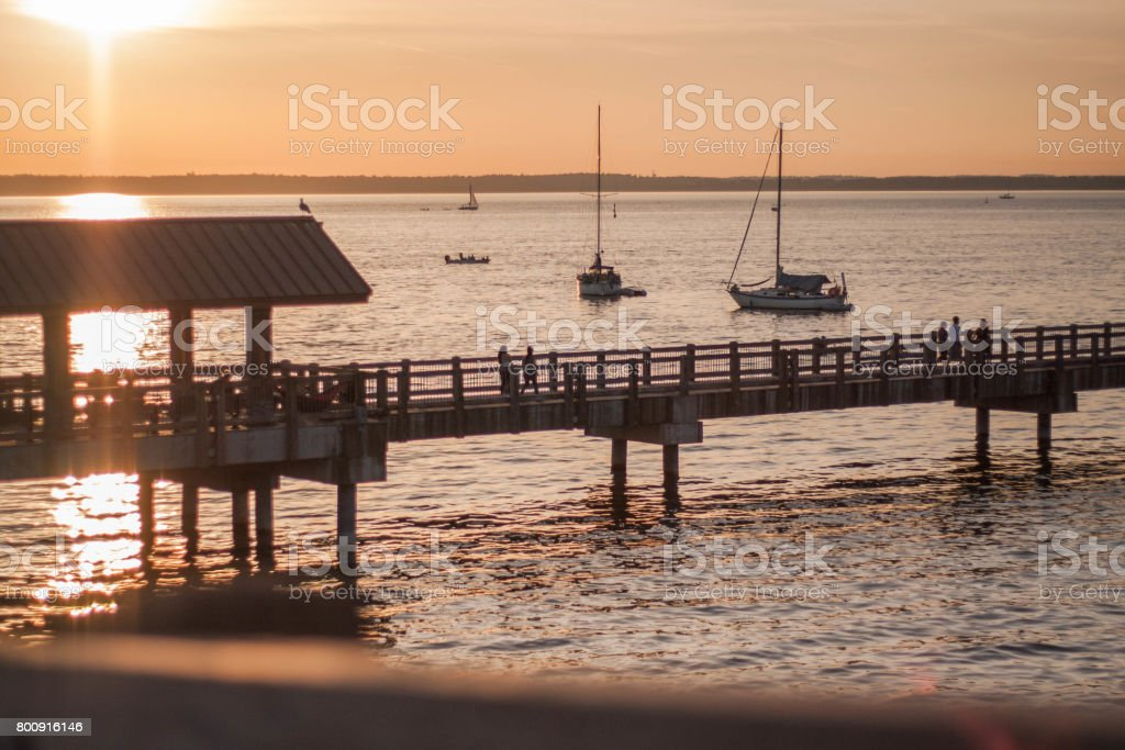A sunset stroll on the boardwalk in the city of Bellingham Washington. stock photo
