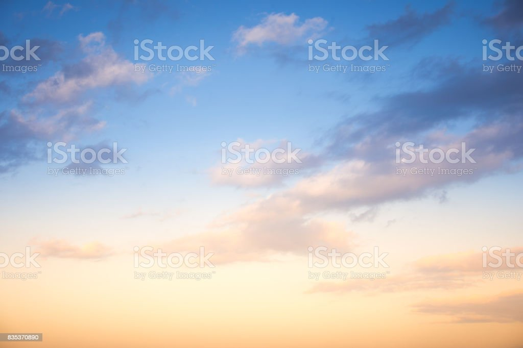 Sunset / sunrise with clouds, light rays and other atmospheric effect stock photo