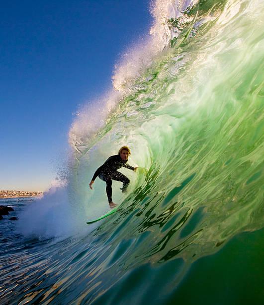 Surfer bei Sonnenuntergang – Foto