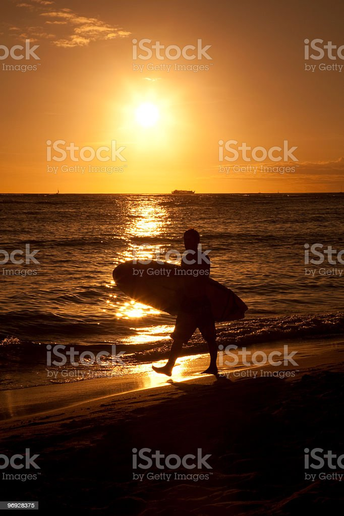 sunset surfer silhouette royalty-free stock photo