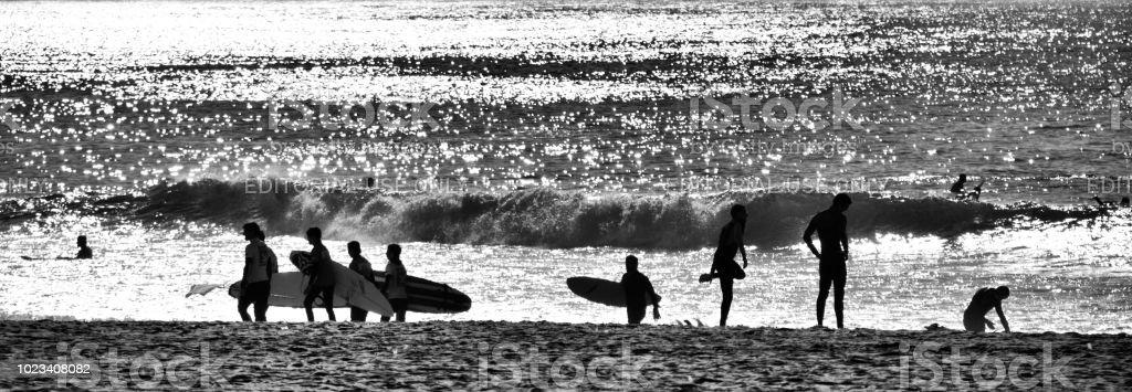 Atardecer Surfers - foto de stock