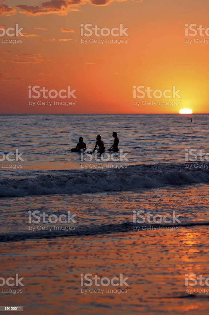 Sunset Surfing royalty-free stock photo