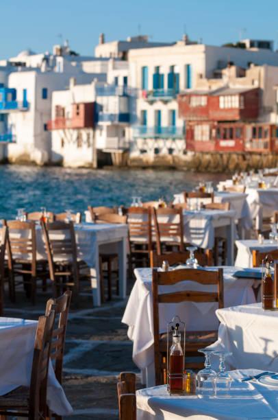 Sunset Tables Mykonos Greece stock photo