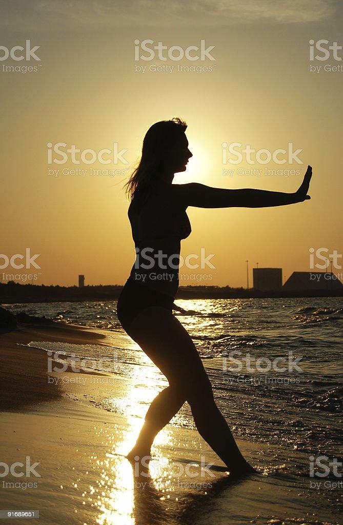 Sunset Tai-Chi on a beach royalty-free stock photo