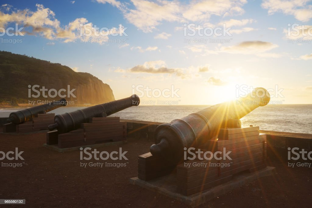 Sunset through cannons in Saint-Denis in Reunion Island stock photo