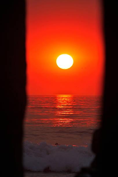 Sunset through Manhattan Beach Pier stock photo