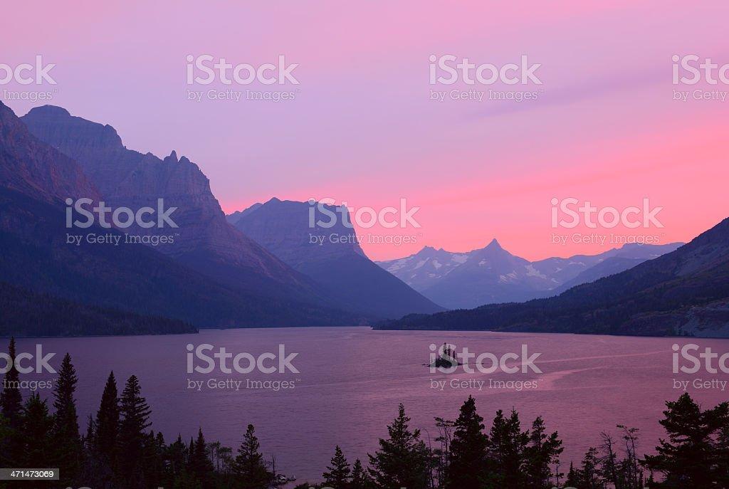 Sunset Through Smoky Sky in Glacier National Park stock photo