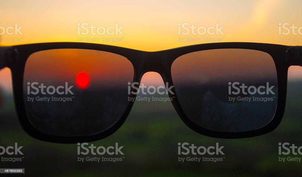 Sunset through sunglasses stock photo